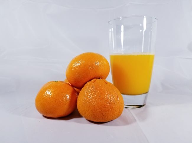 Mandarin oranges and a glass of orange juice