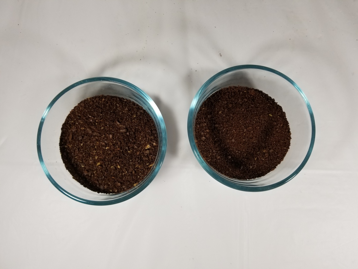 A container with coffee grounds from a coffee grinder on the left, and a container with coffee grounds from a blender on the right